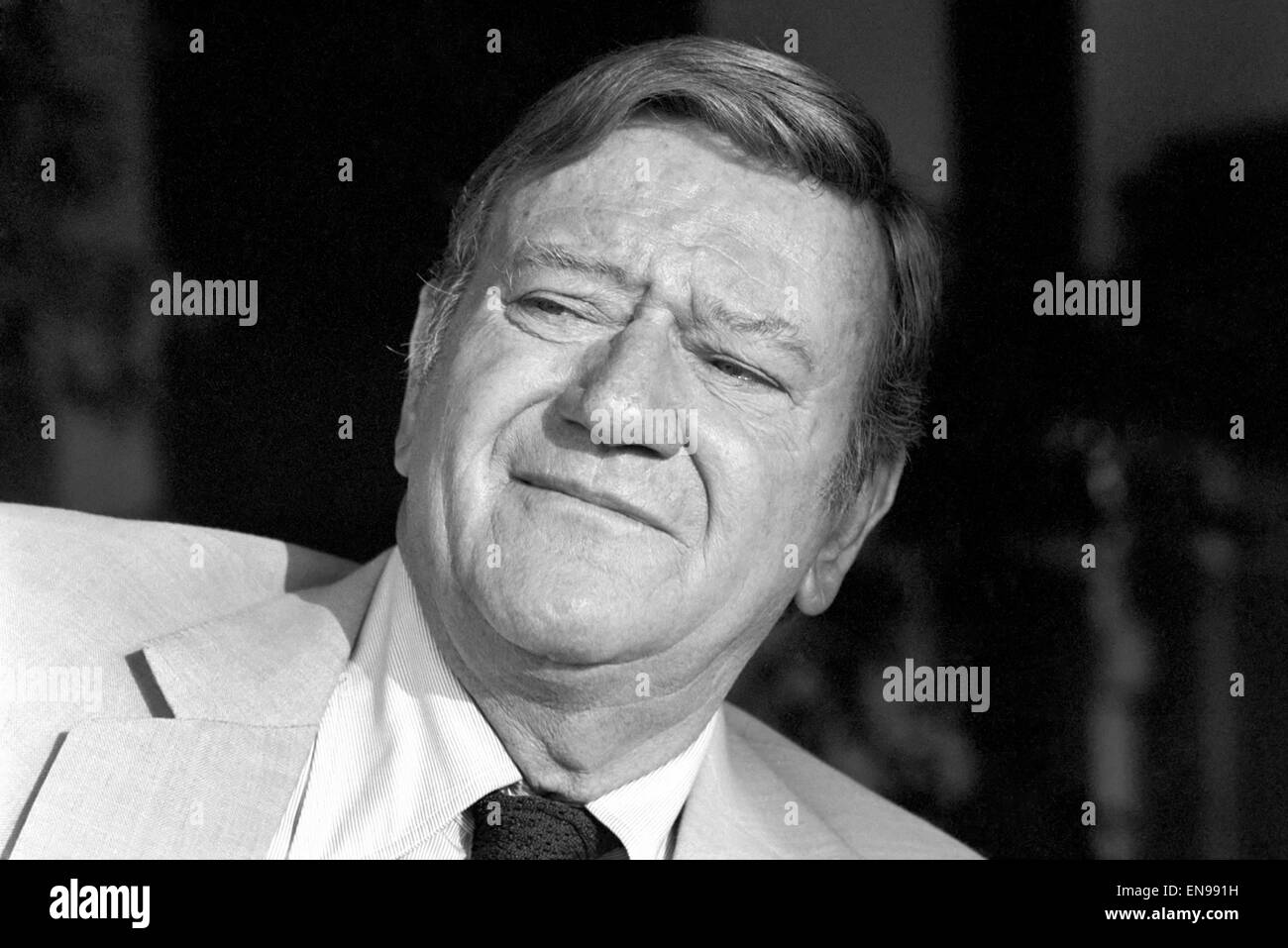 John Wayne who stars in 'Brannigan' seen here at home in Texas. 8th June 1975 - Stock Image