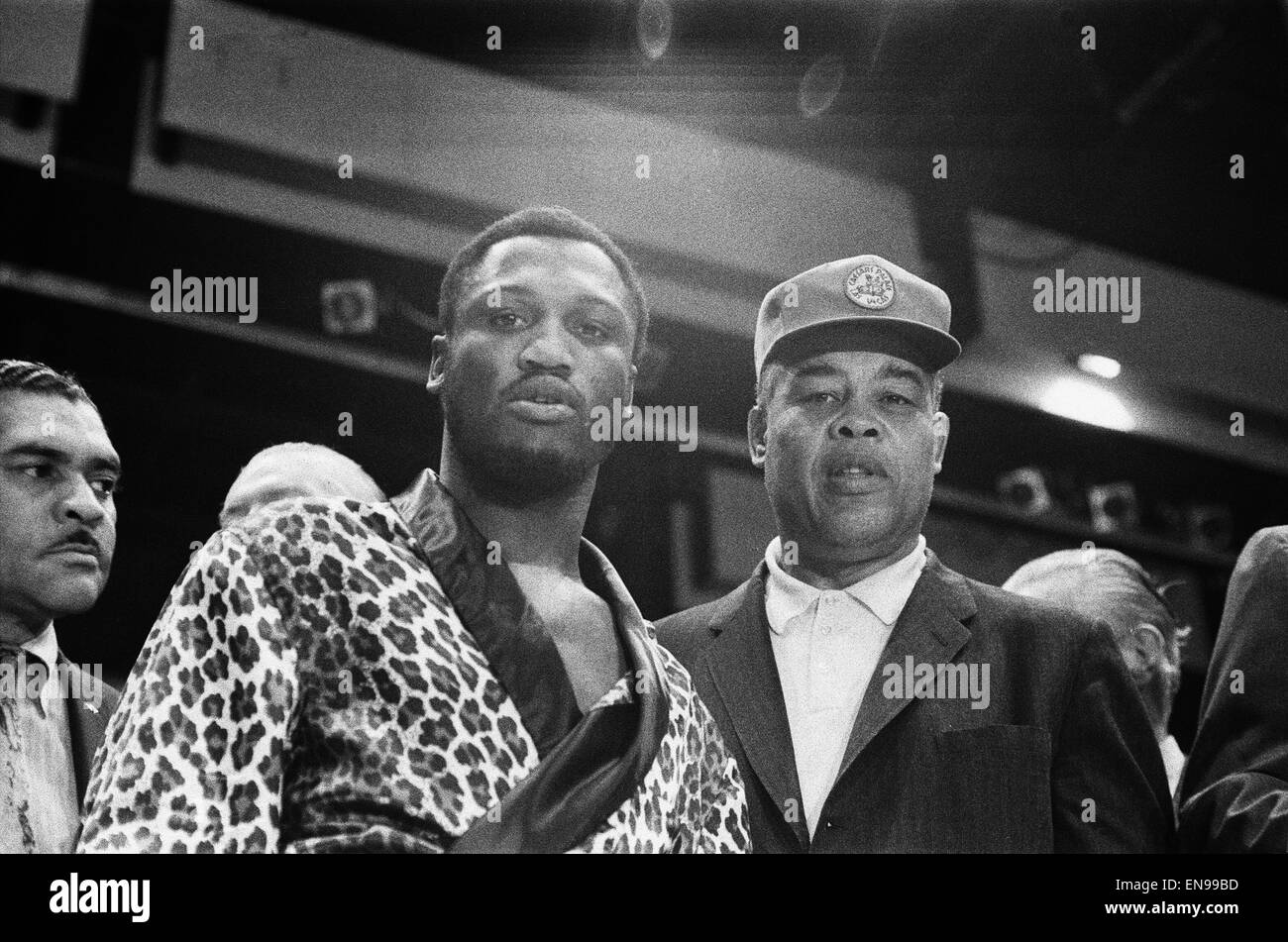 World Champion Joe Frazier (left) seen here with former World Champion Joe Louis, at the pre fight medical for Joe - Stock Image
