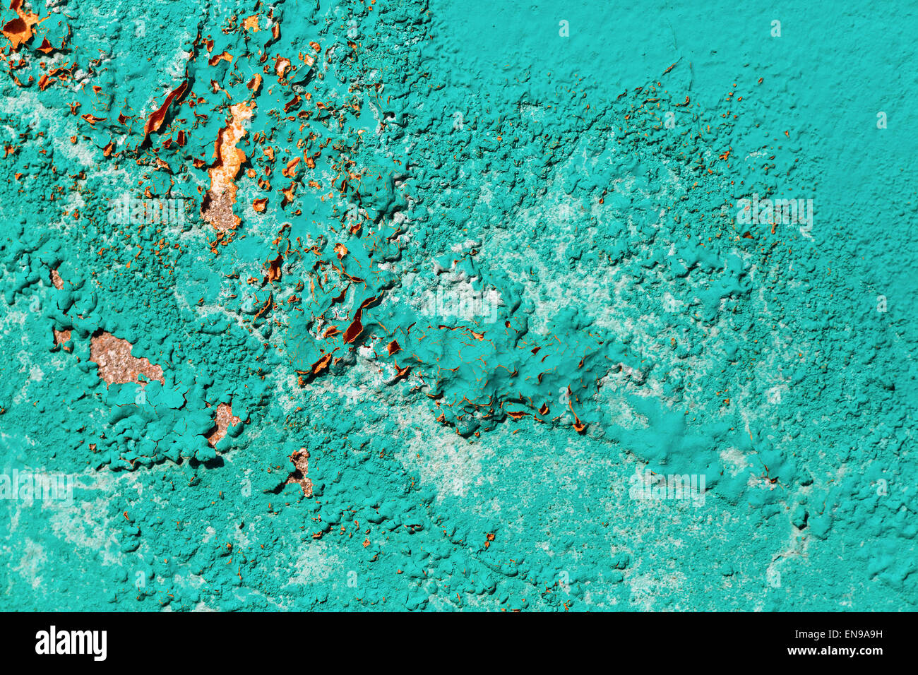 light turquoise paint soft peeling paint texture turquoise background fragment of the old wall painted bright turquoise paint cracked over time