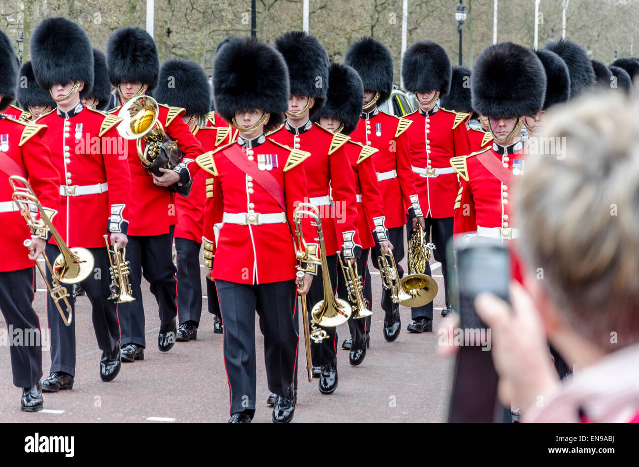 A woman takes a photo with a mobile phone of the Changing of the Queen's Guard, The Mall, London, UK - Stock Image