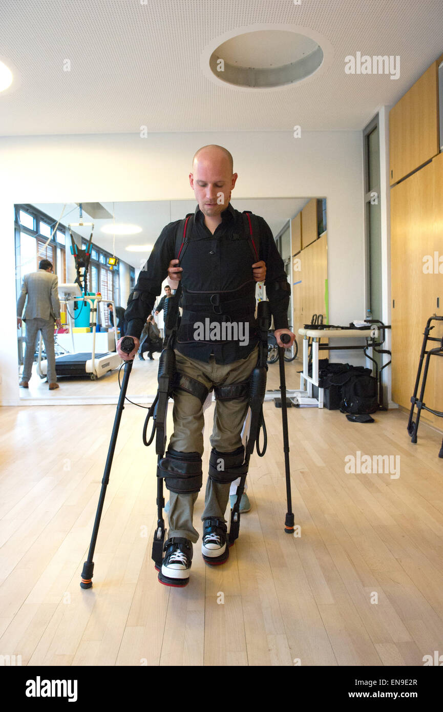 Berlin, Germany. 22nd Apr, 2015. Patient Sebastian Erhardt wears a robotic walking aid at the Vivantes hospital - Stock Image