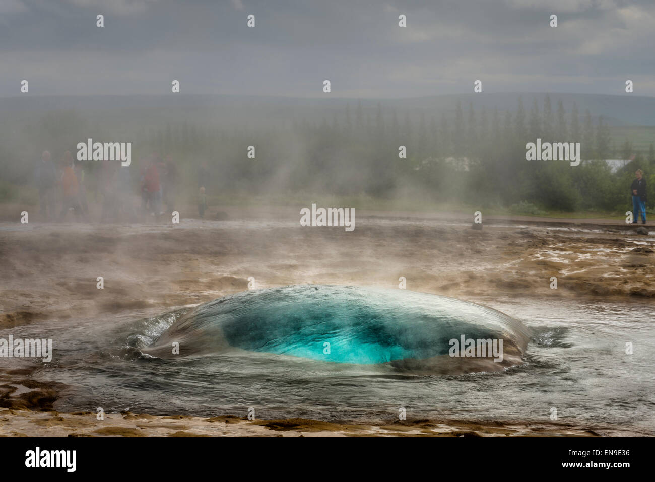 Strokkur Geyser just before it erupts, Iceland. Strokkur is a fountain geyser in the geothermal area beside the - Stock Image