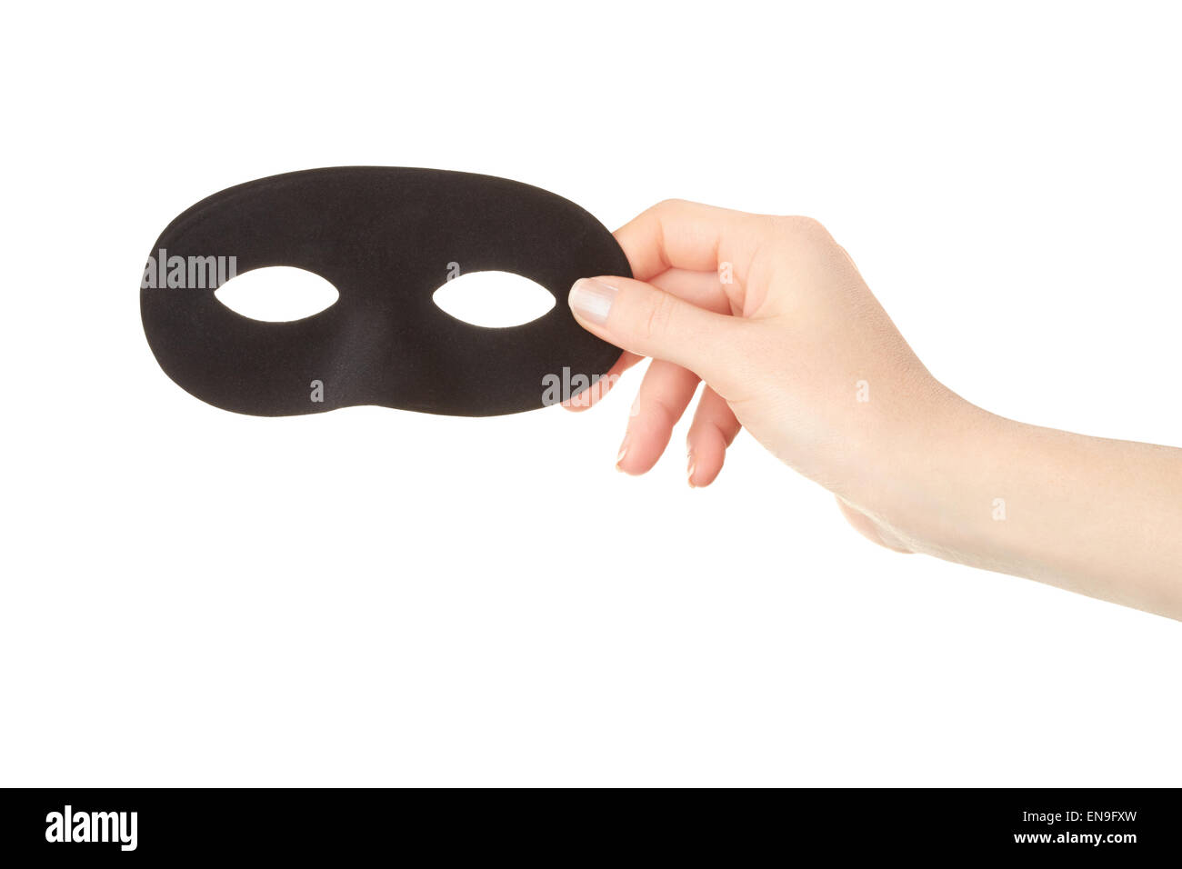 Woman hand holding black mask - Stock Image