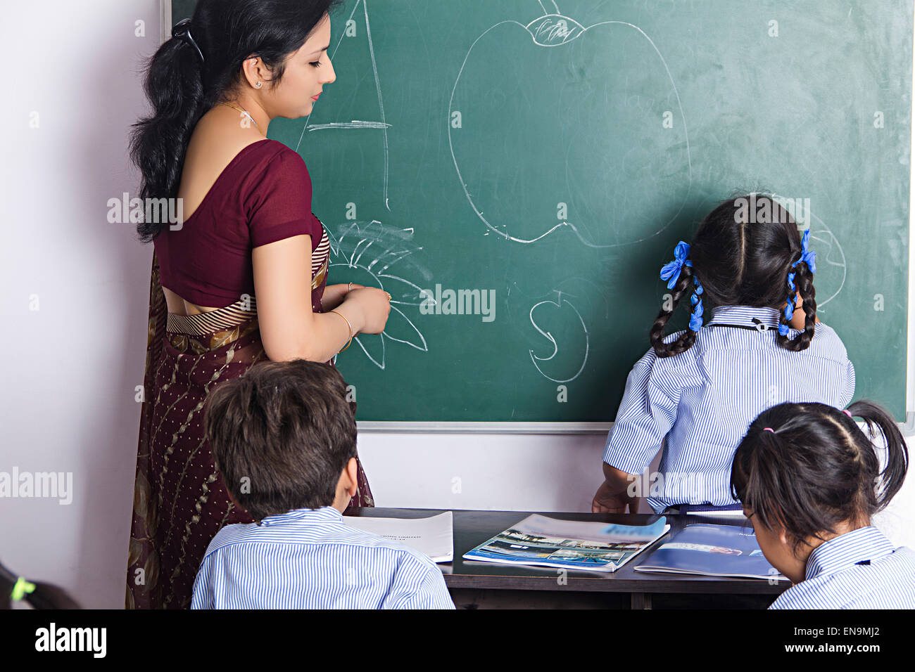 Indian teachers teaching children
