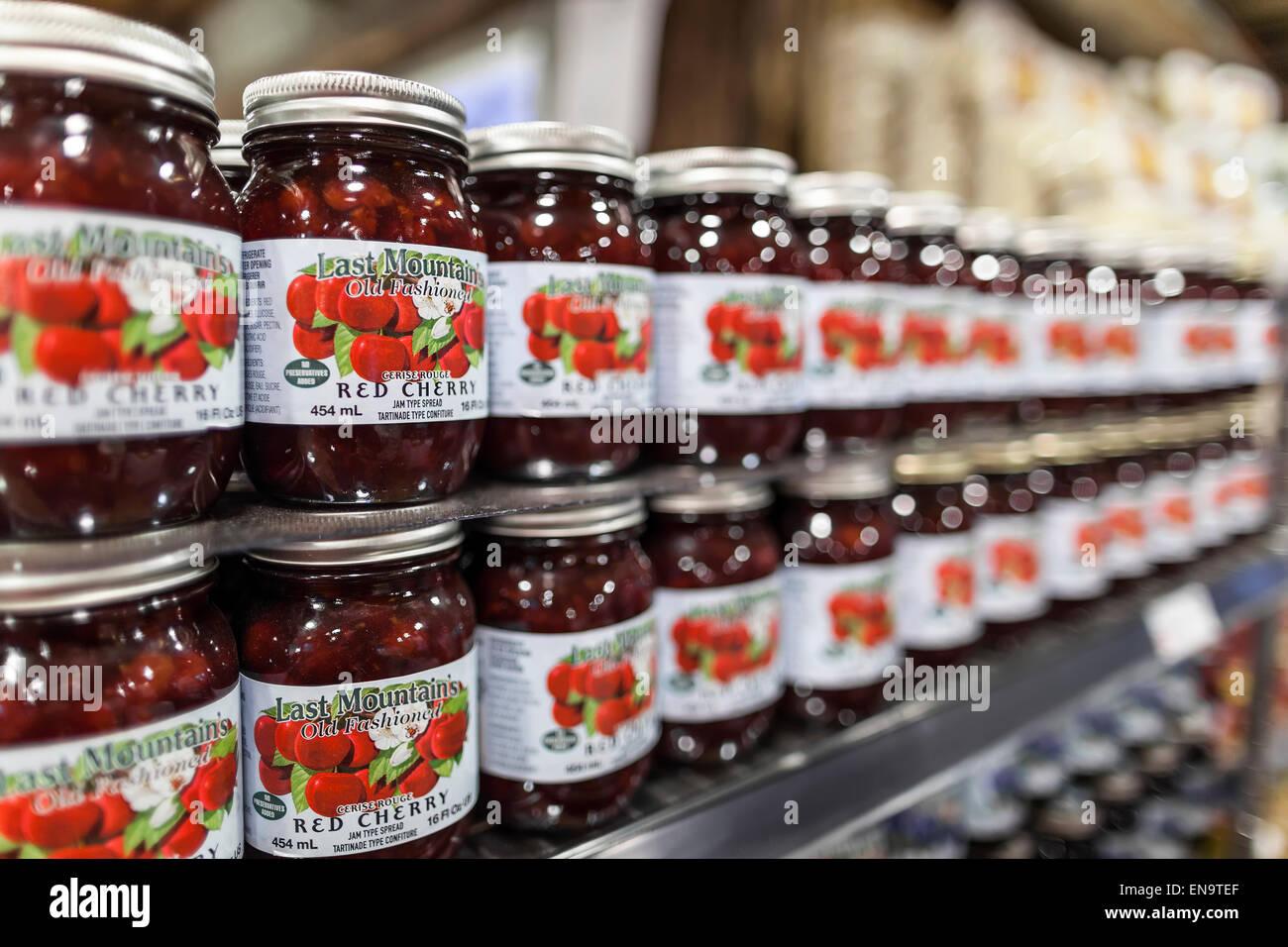 Jars of Red Cherry Jam - Stock Image