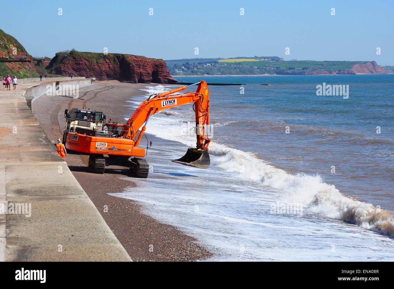 Maintenance digger on the beach near Dawlish, Devon, England, UK - Stock Image