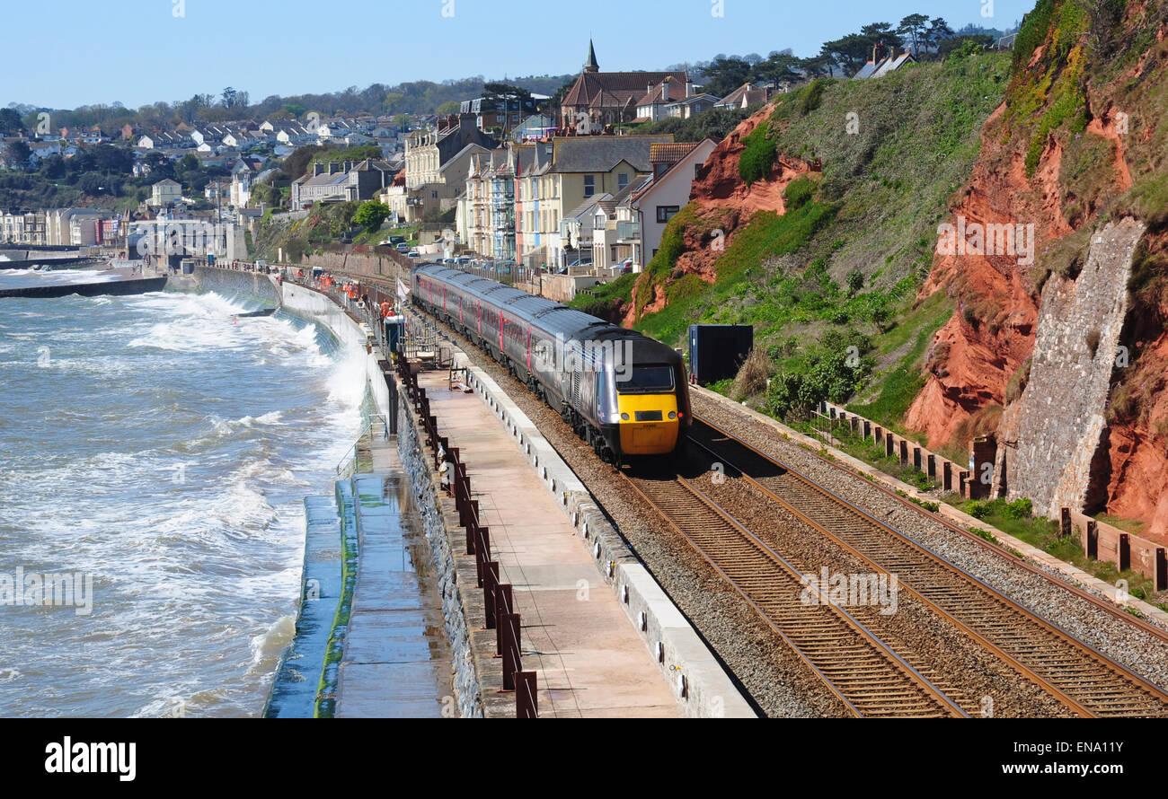 HST express passenger train heading west through Dawlish, Devon, England, UK - Stock Image
