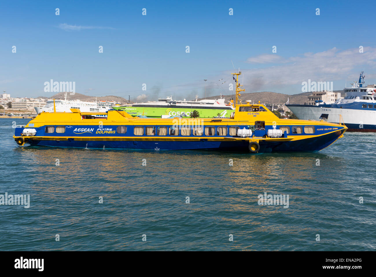 The hydrofoil ferry Flying Dolphin Athina (IMO 8859184) from Aegean Flying Dolphins arrives at Piraeus harbour. - Stock Image