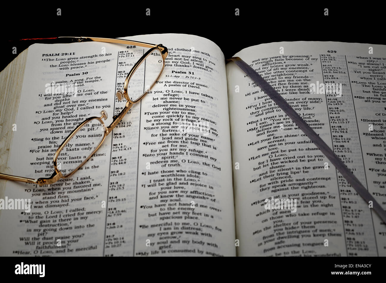 Bible Study Psalm 30 In Evening Light With Reading Glasses On Black Stock Photo Alamy