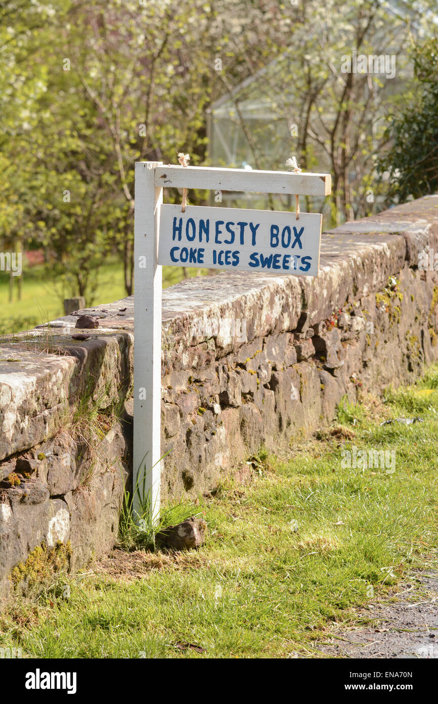 Honesty box sign in Scottish village advertising Coke, Ices and sweets - Stock Image