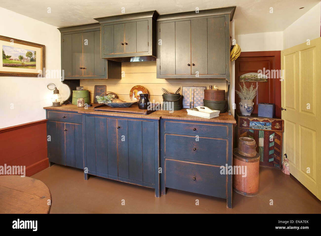 The kitchen in a primitive colonial style reproduction home - Stock Image