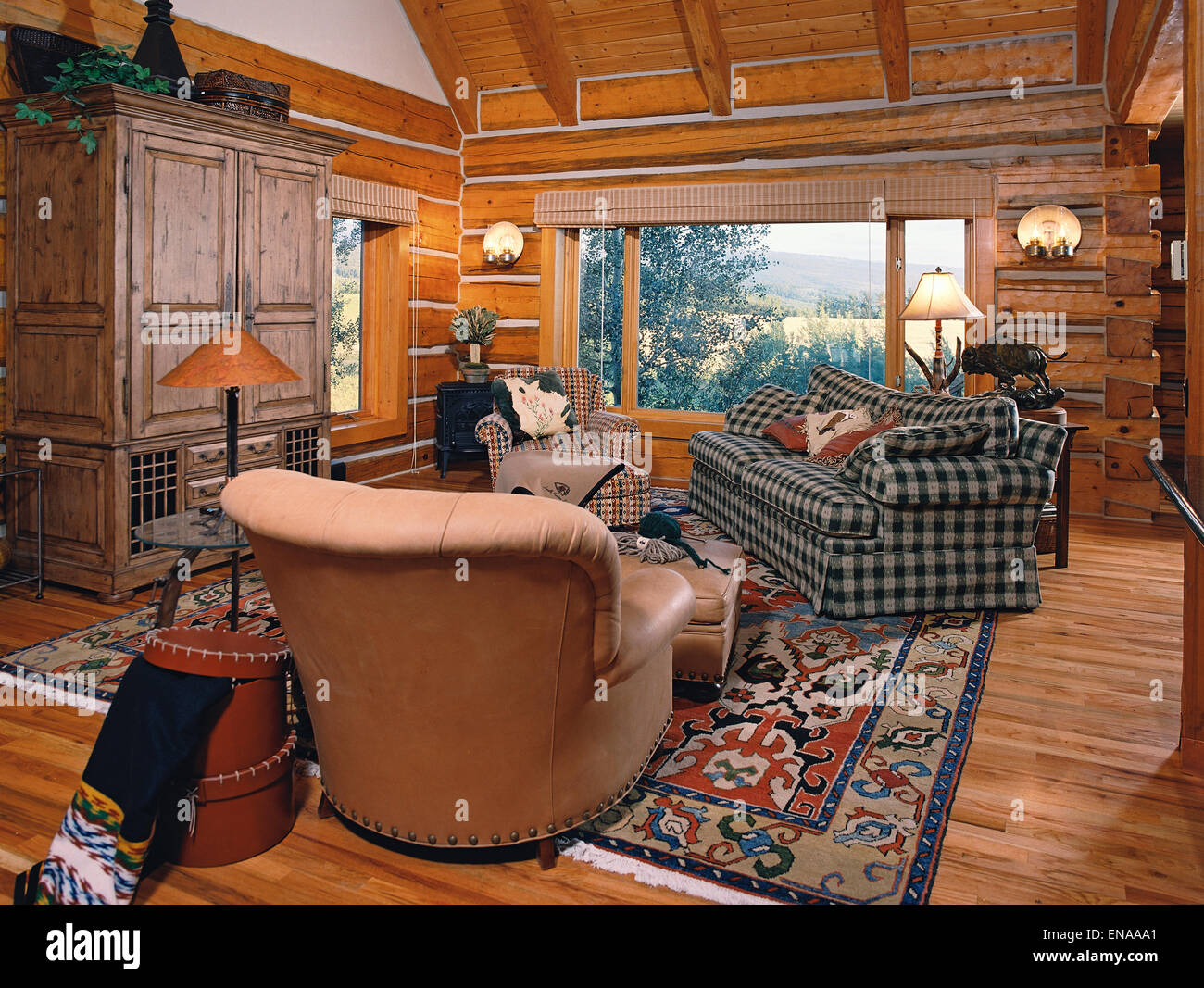 The sitting room in a modern Log cabin in the Mountains. - Stock Image