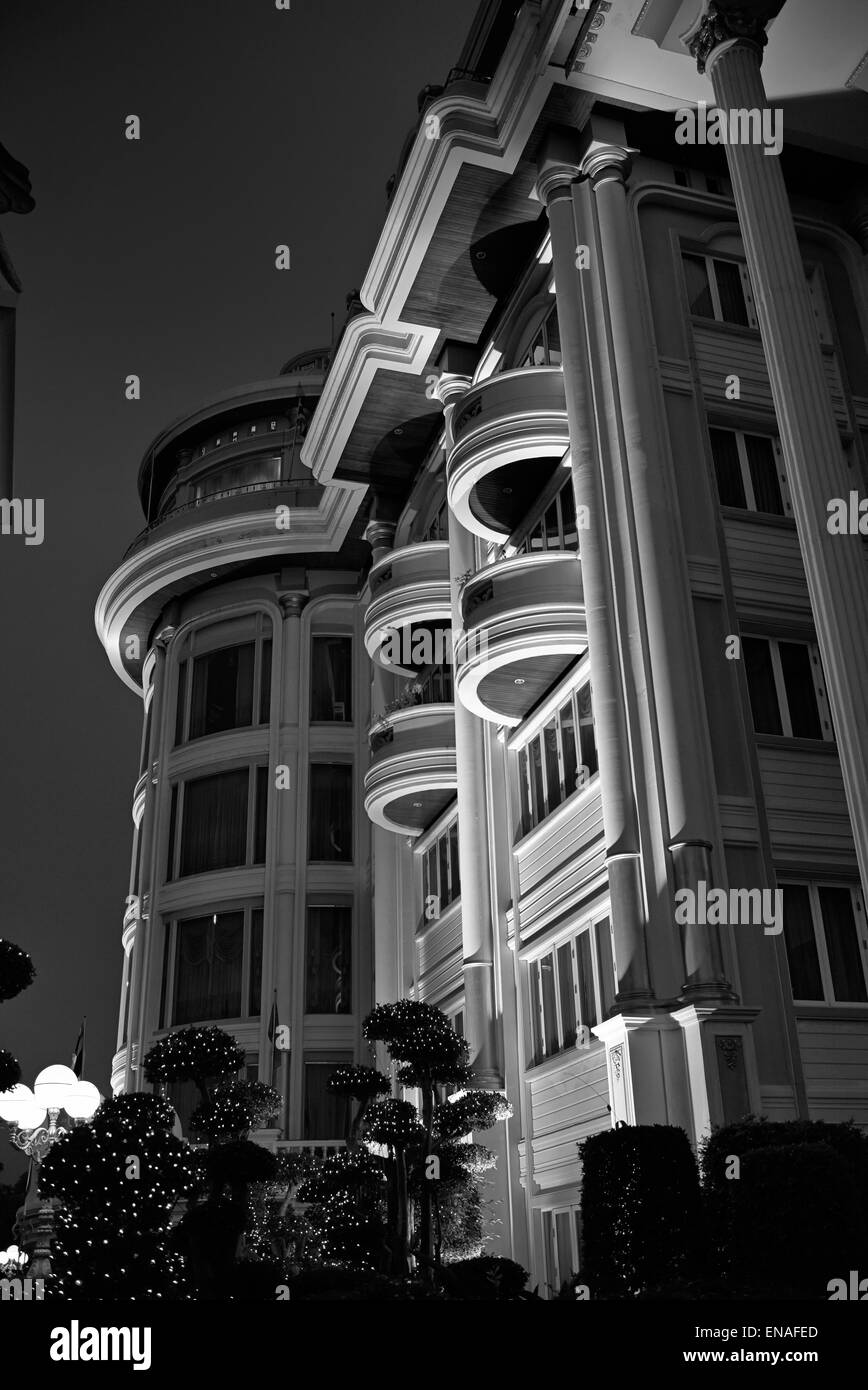 Apartment block lit at night and viewed from below. Black and white photography - Stock Image