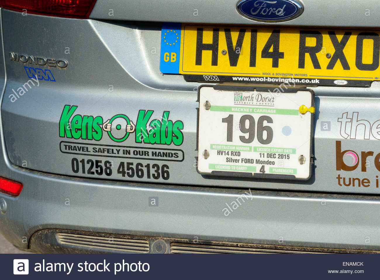 Hackney carriage plate on the back of local taxi cab, Blandford Forum, Dorset, England UK - Stock Image
