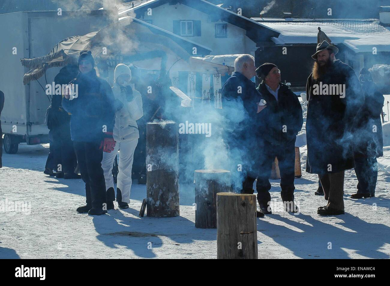 One of the great attractions in winter at Rottach-Egern - the horse-drawn sleigh race! spectators gathering round - Stock Image