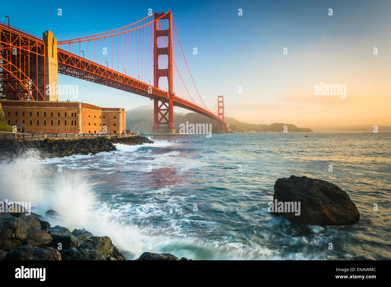 The Golden Gate Bridge, seen at sunrise from Fort Point, San Francisco, California. - Stock Image