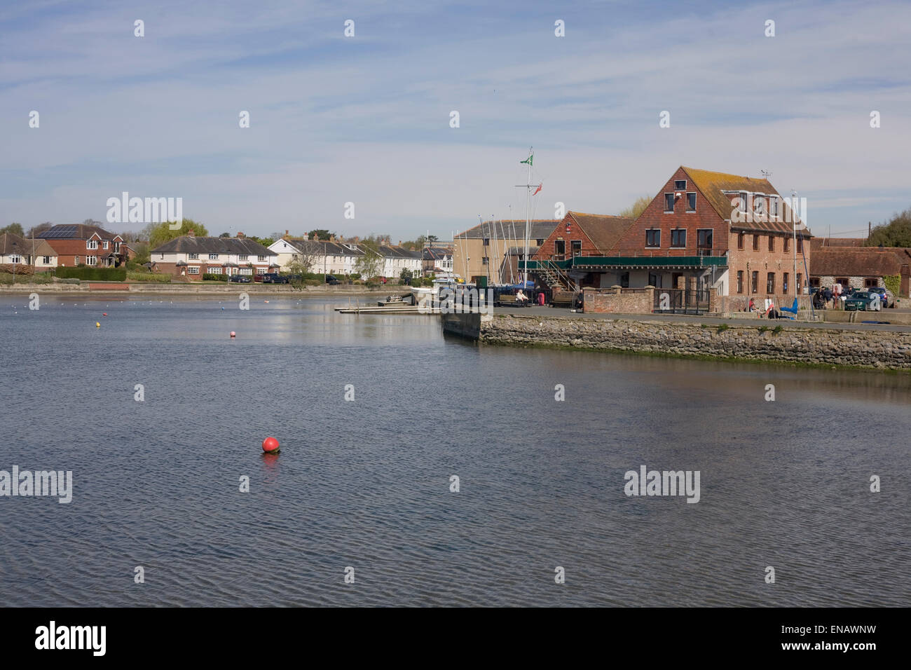 Emsworth harbour with Essc building, rippled water and distant houses - Stock Image