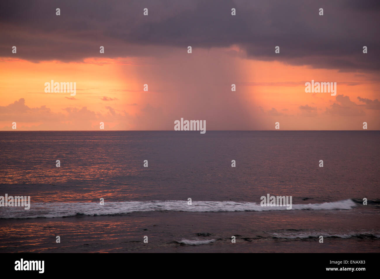 Rainstorm and clouds at sea at sunset viewed from Galle, Sri Lanka, Asia - Stock Image