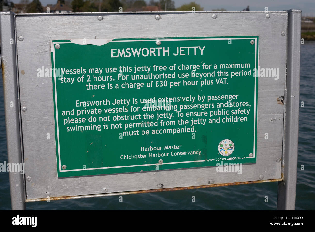 Notice from Harbour master of Chichester harbour conservancy on Emsworth jetty about embarkation and mooring - Stock Image