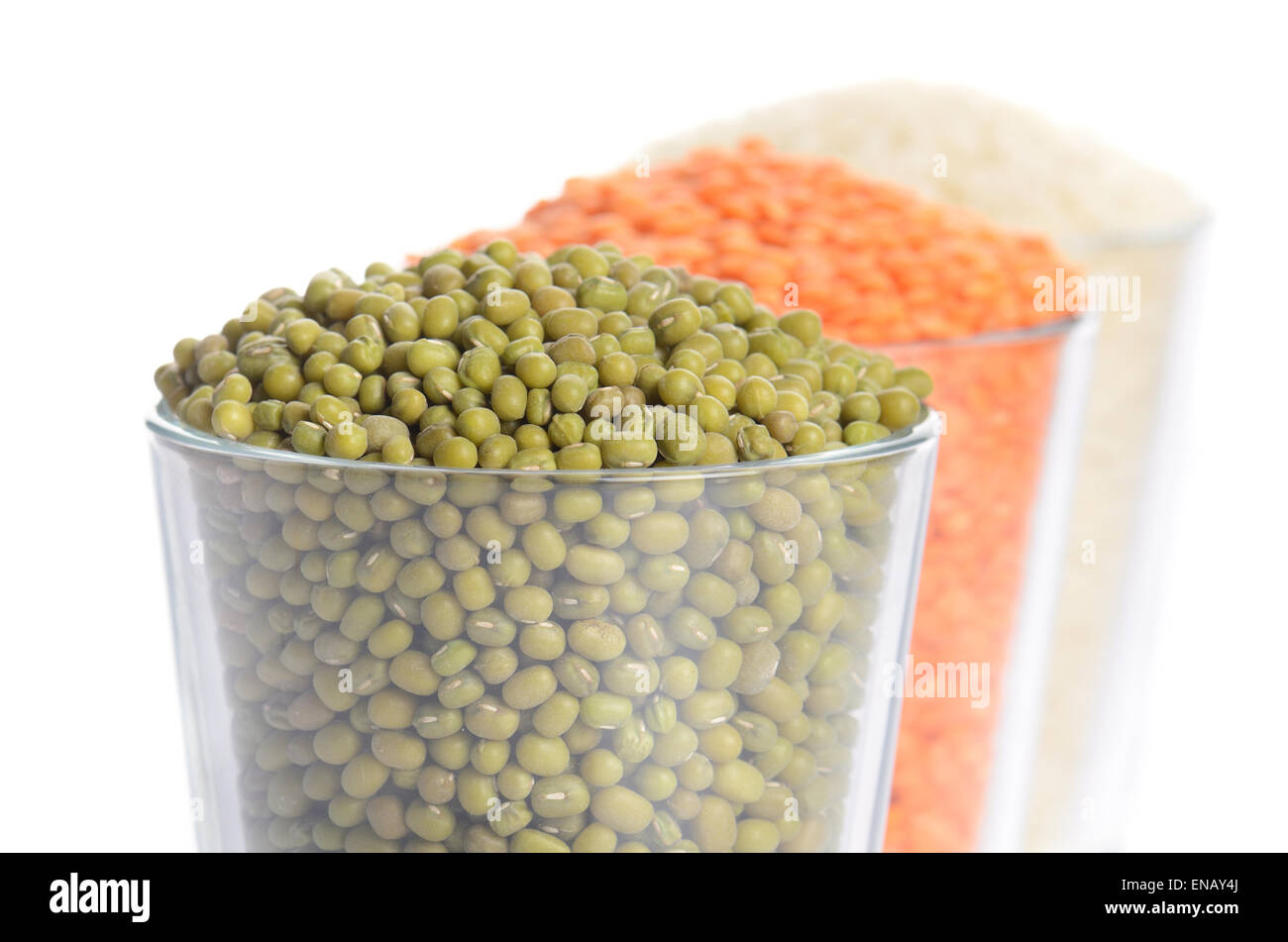 full glasses with mung, lentil and rice isolated on white - Stock Image