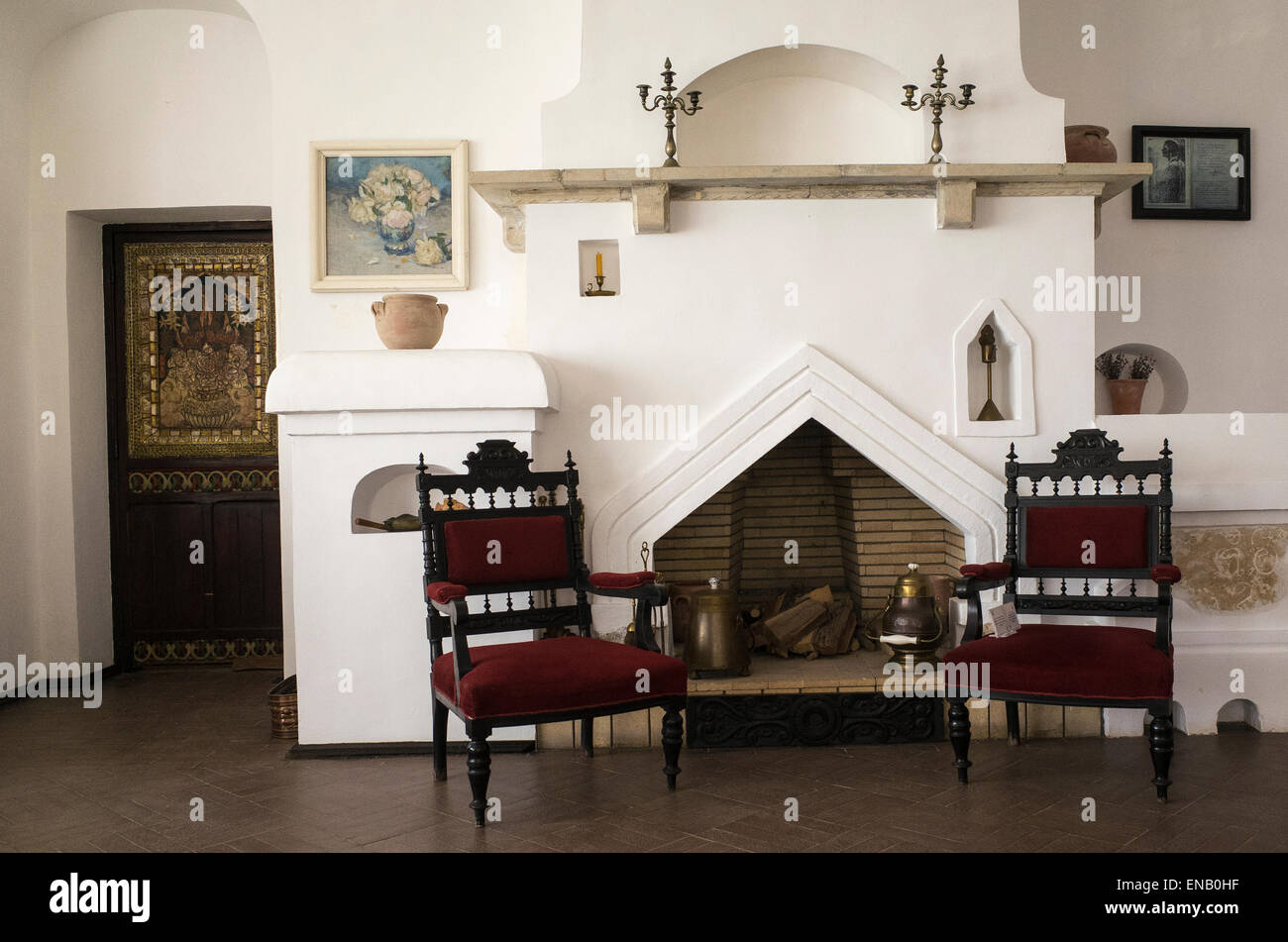 Antique furniture and fireplace in the main room of The Balchik Palace, the summer retreat of queen Marie of Romania - Stock Image