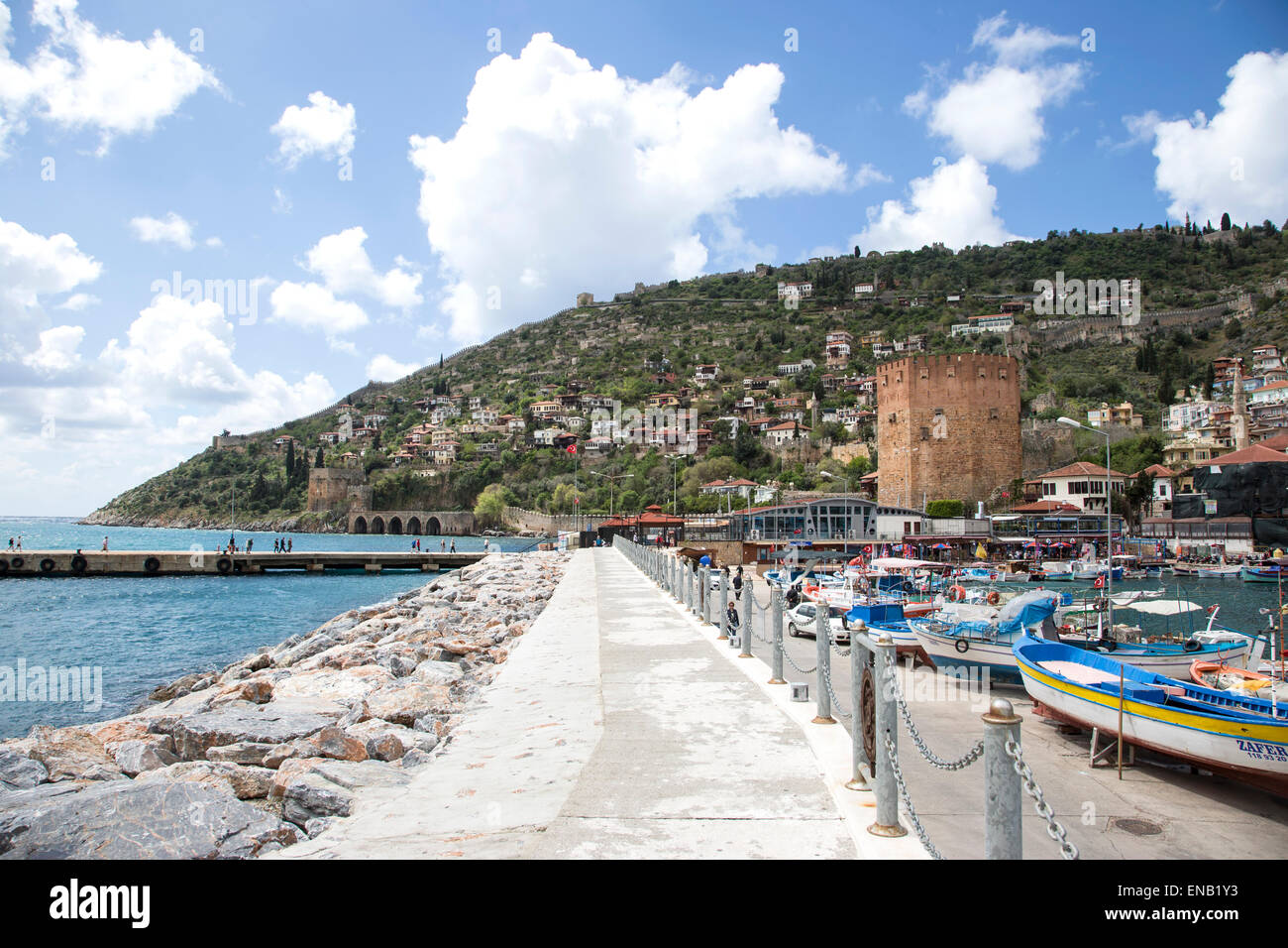 Alanya harbor harbour and marina with the Red Tower Kizil Kule a historical symbol of the city - Stock Image
