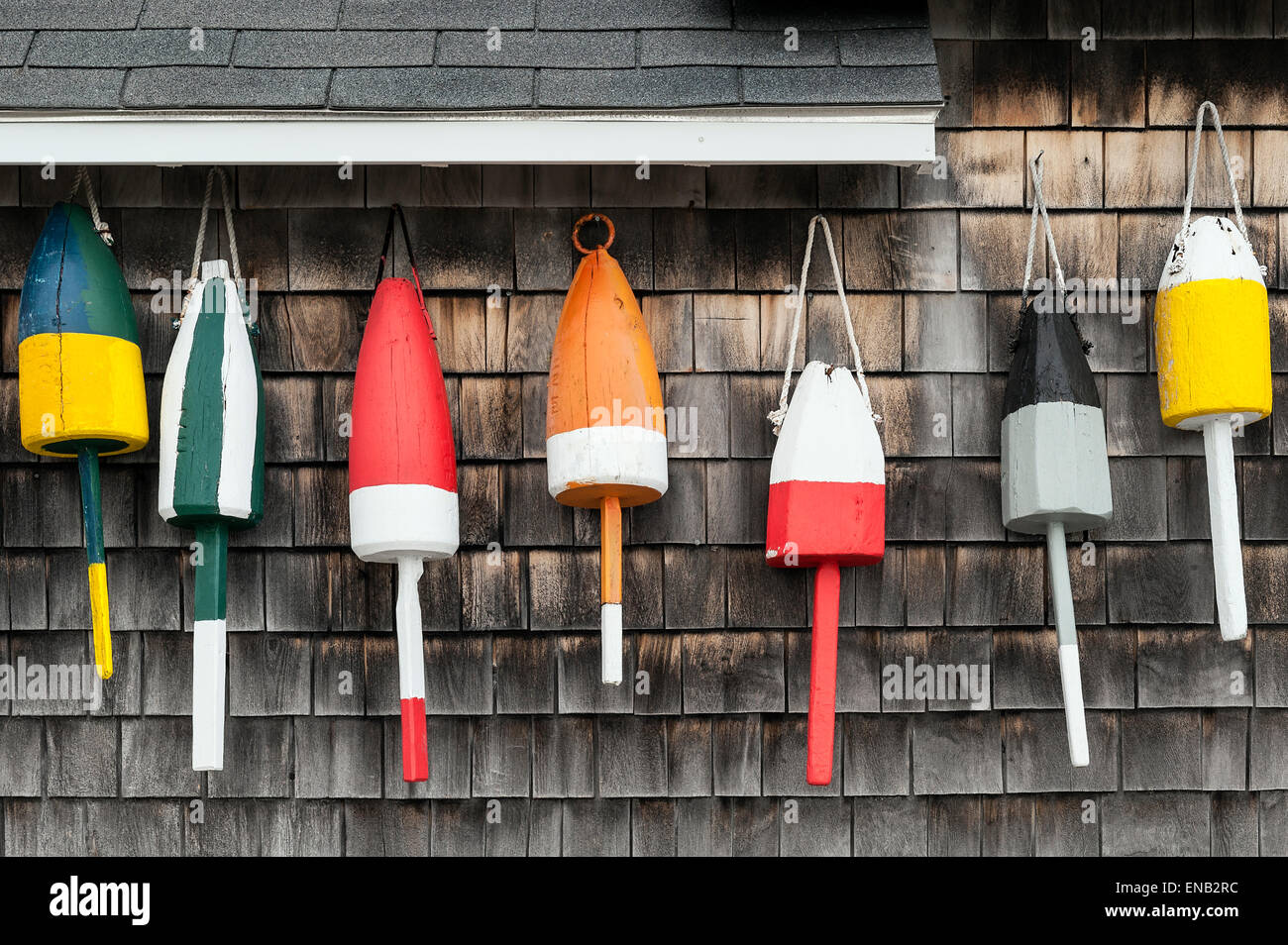 Buoys hung on the facade of a rustic coastal shack, Maine, USA - Stock Image