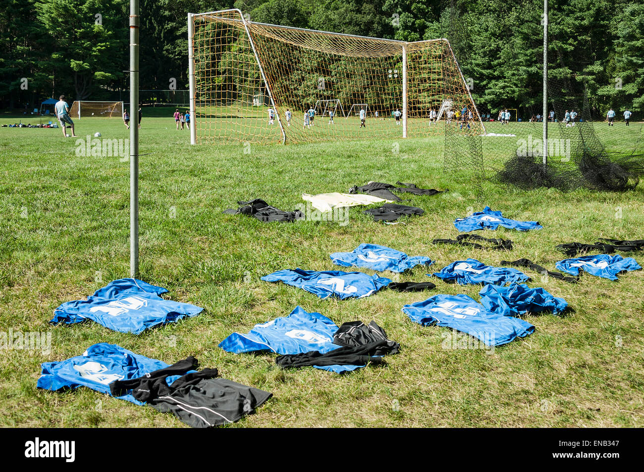 Soccer jerseys lay out to dry between games at a soccer tournament. - Stock Image