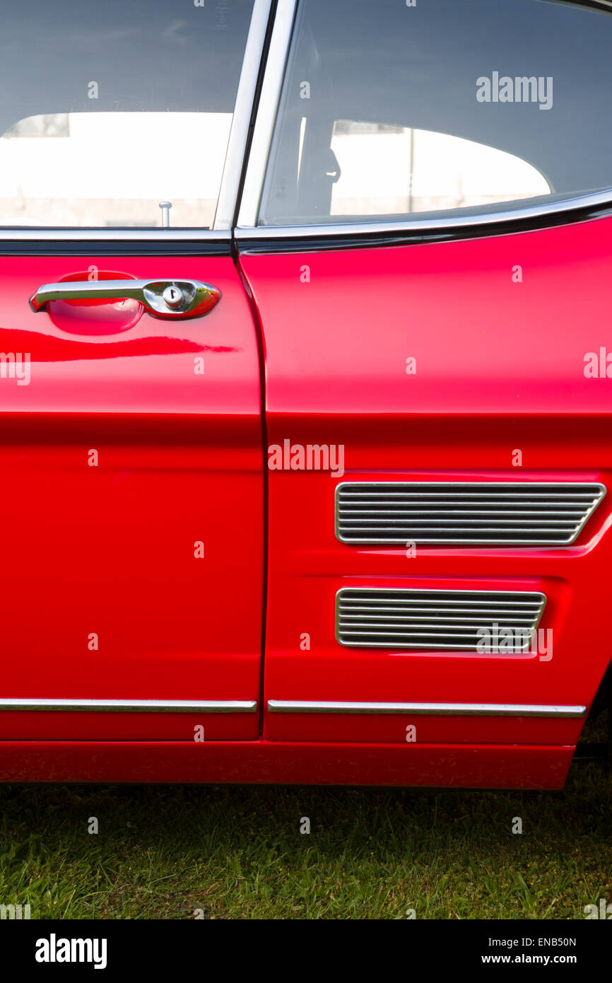 Ford Capri MKI in red with a Burton Engine, side vents showing door and rear wing detail - Stock Image