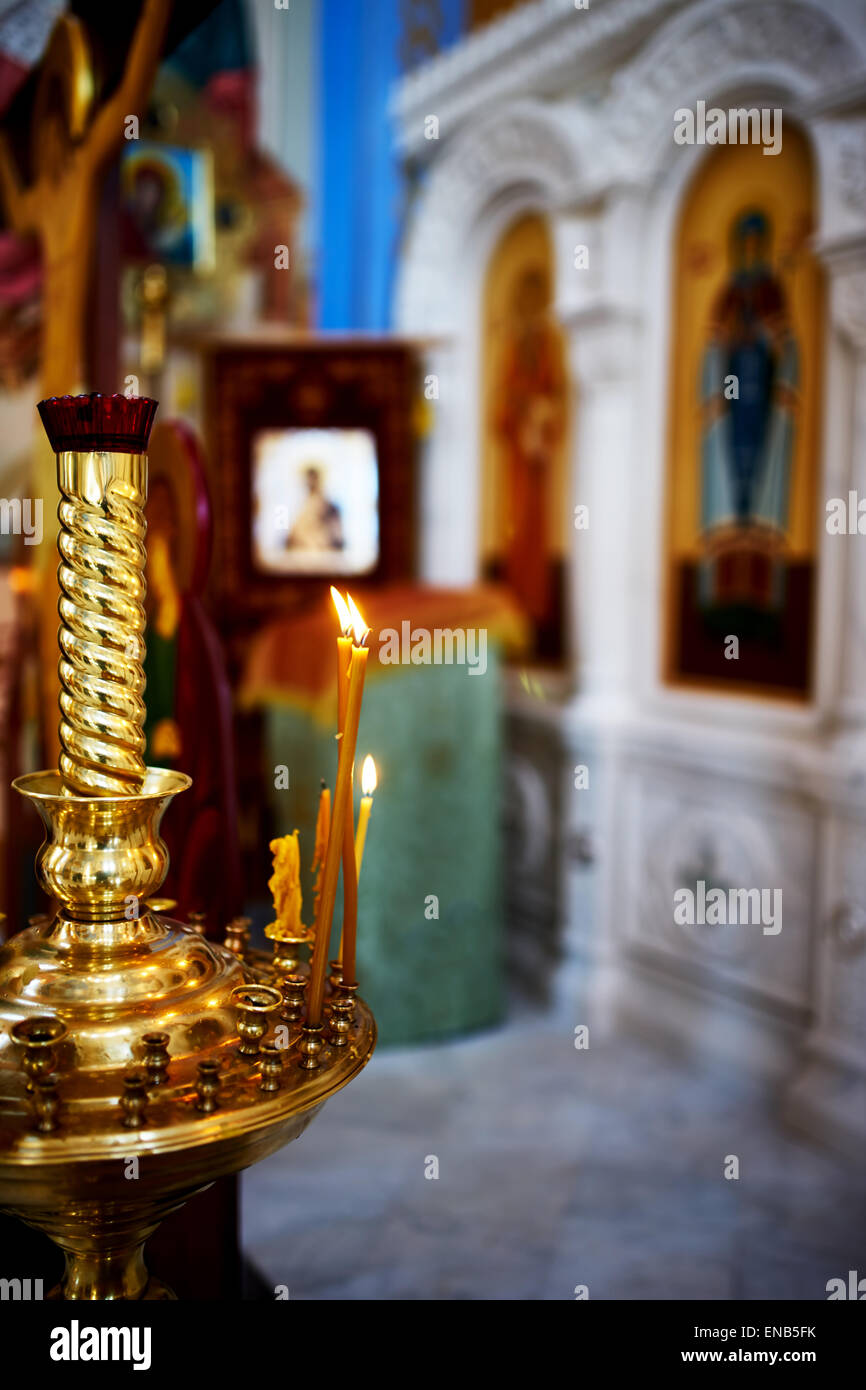 Candlestick with burning candles in a church - Stock Image