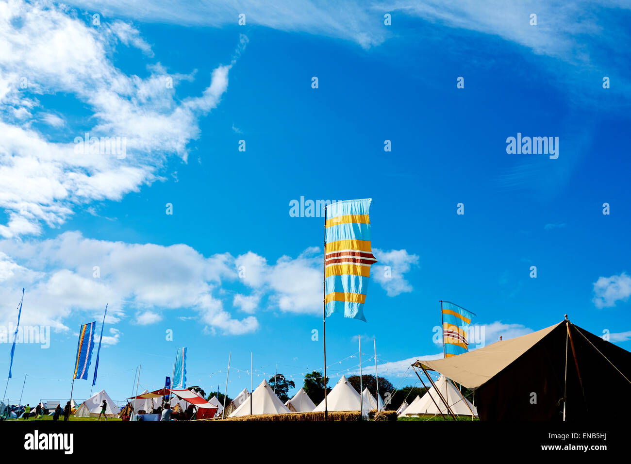The boutique camping area at Festival No.6, Portmeirion, Wales, UK and people wake boarding - Stock Image