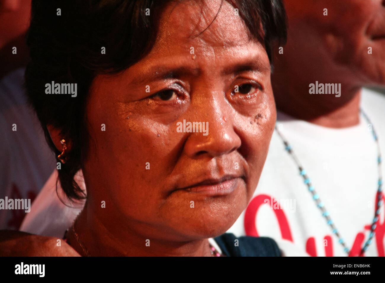 Manila, Philippines. 01st May, 2015. The teary eyed mother of Mary Jane Veloso faced the crowd of protesters in - Stock Image