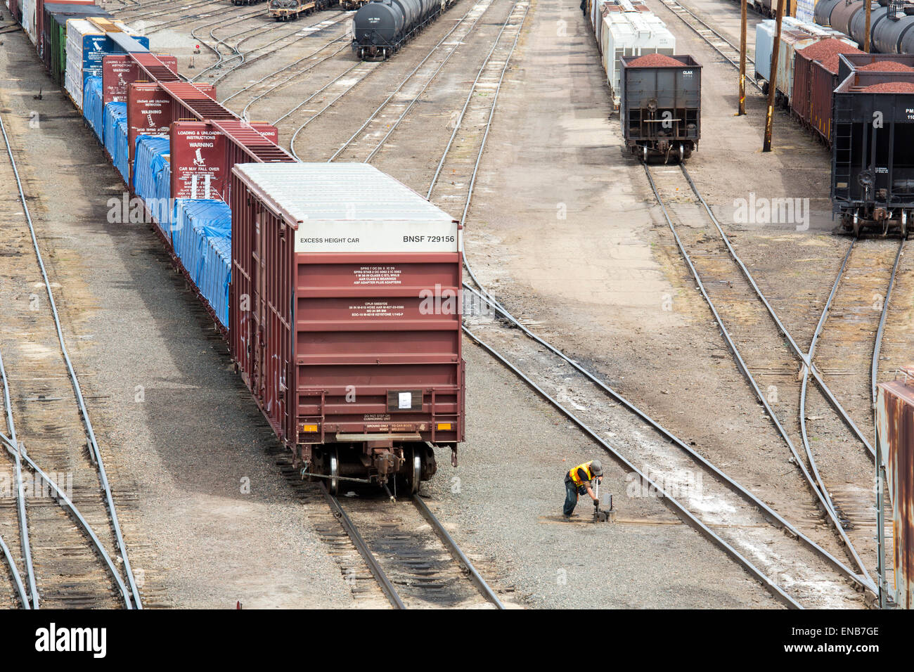 Denver, Colorado - A worker throws a switch in the Union Pacific Denver North Rail Yard. - Stock Image
