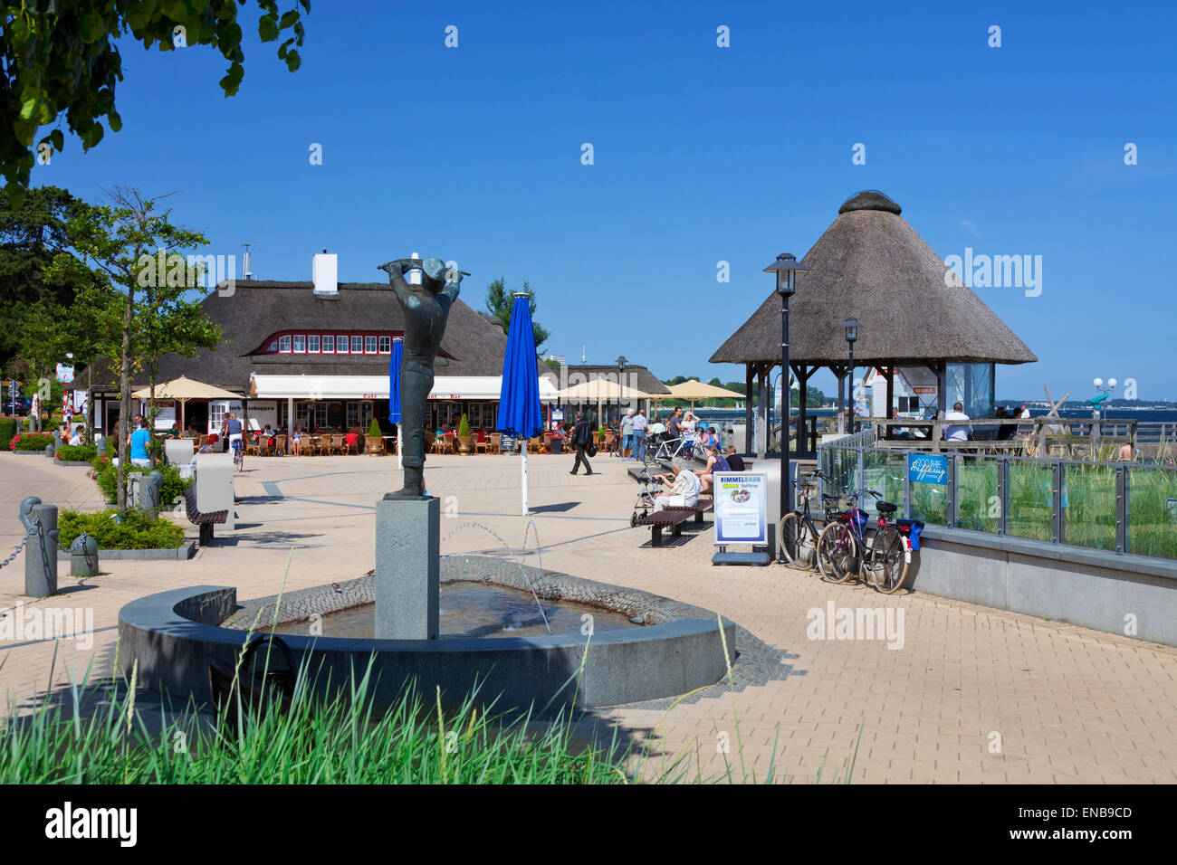 Statue and café restaurant along the promenade at the seaside resort Haffkrug, Scharbeutz, Schleswig-Holstein, - Stock Image