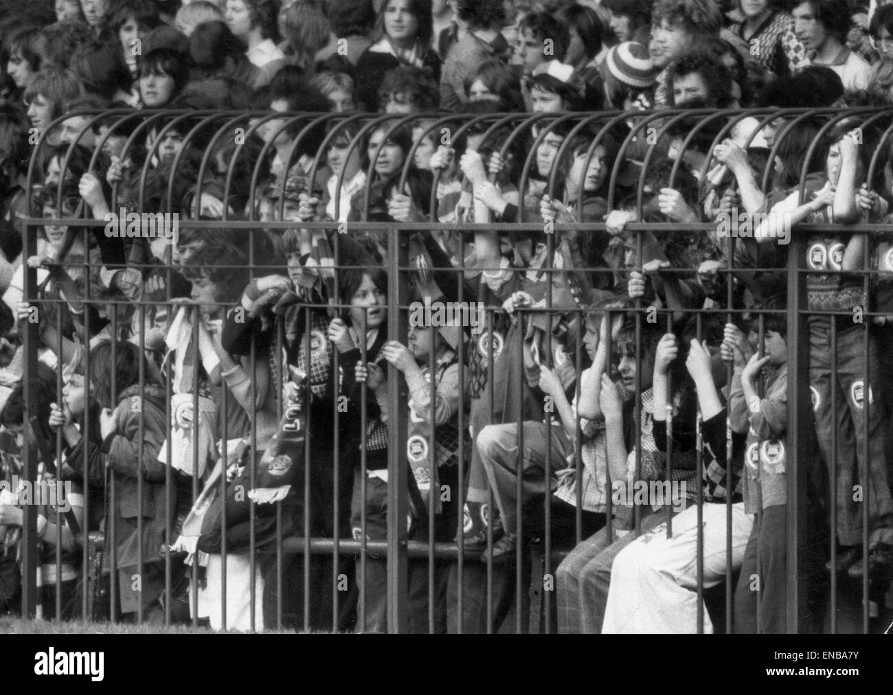 A section of the caged fans at the Stretford End of Old Trafford watching the match. Circa August 1974. - Stock Image