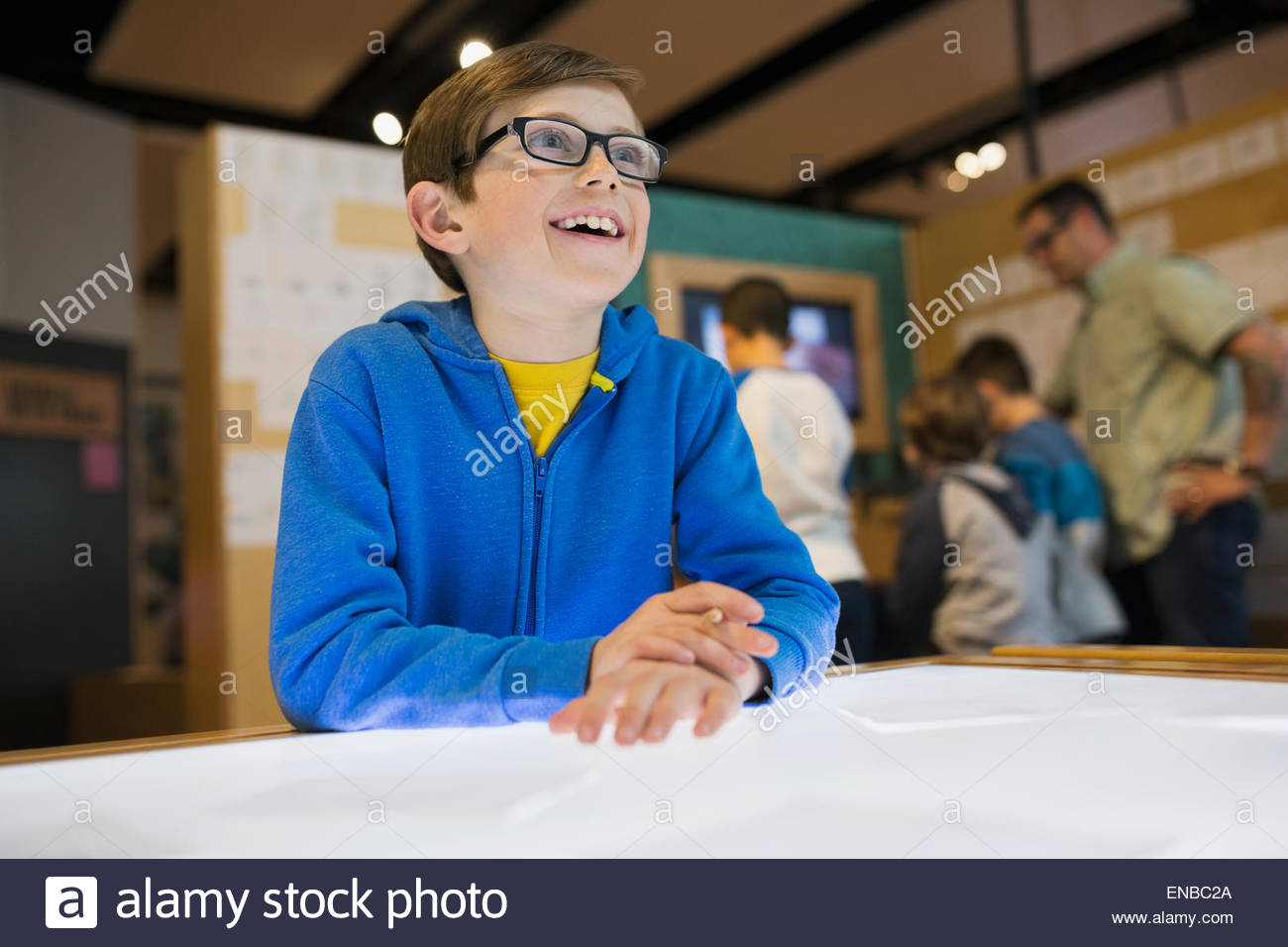 Smiling boy at light table at science center - Stock Image