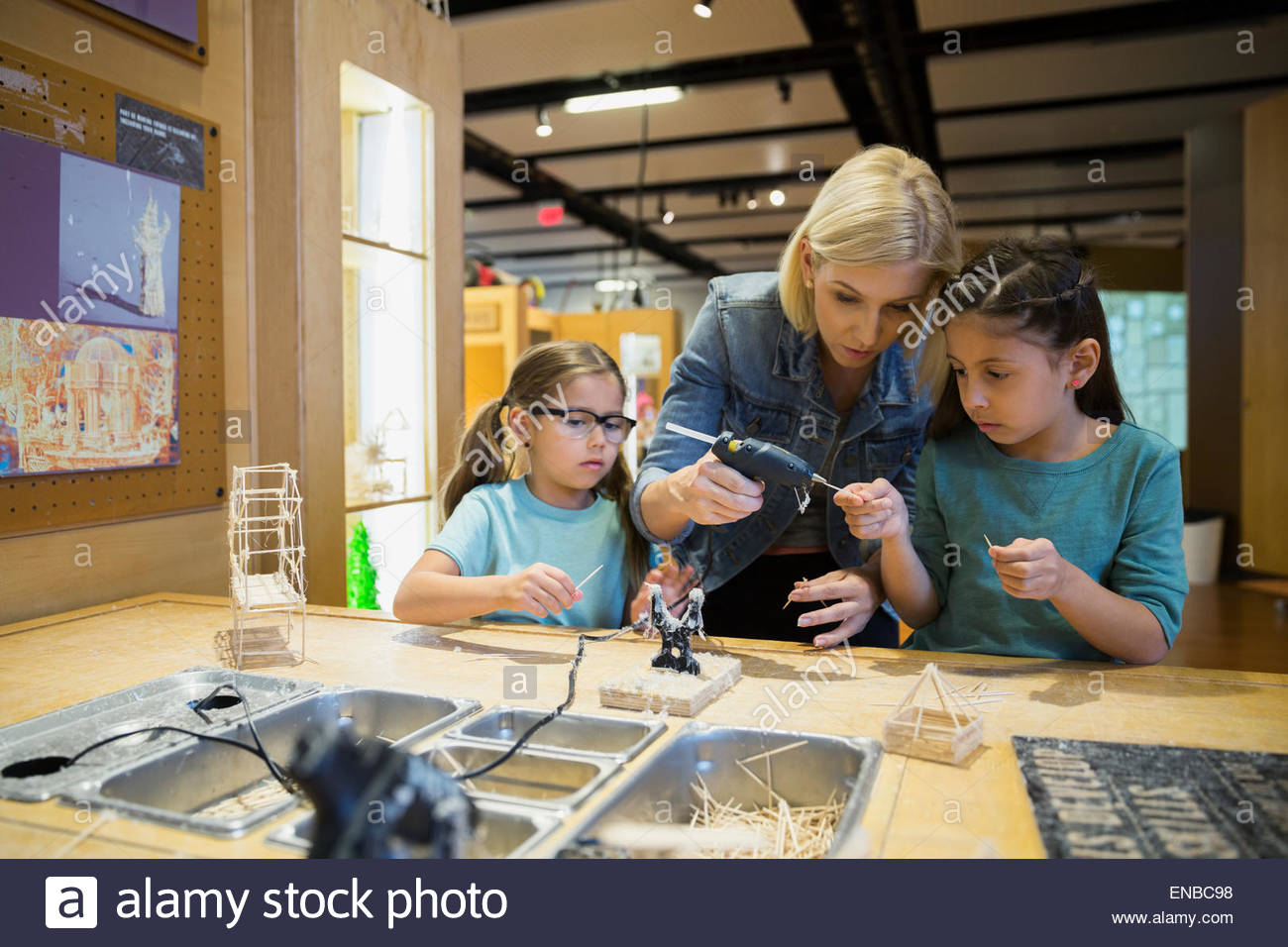 Family assembling toothpick models science center - Stock Image