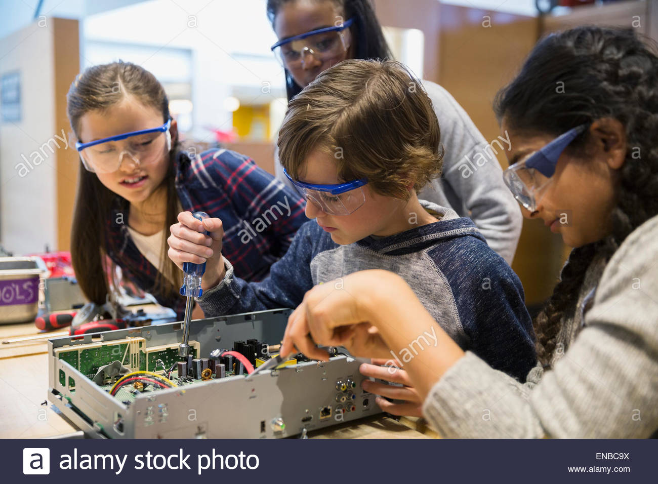 Students in goggles assembling electronics at science center Stock Photo
