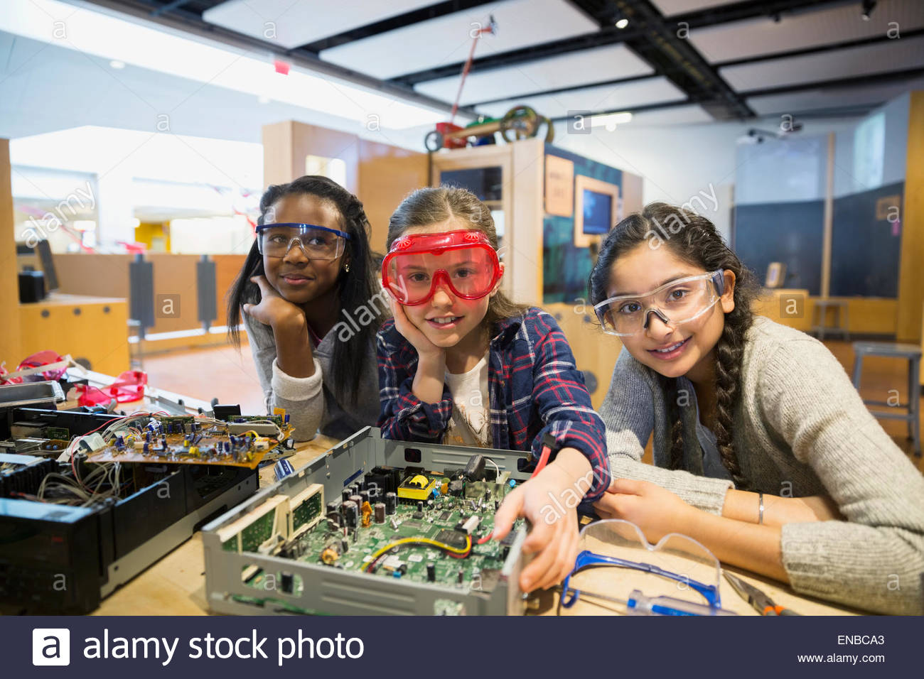 Portrait of girls goggles assembling electronics science center - Stock Image