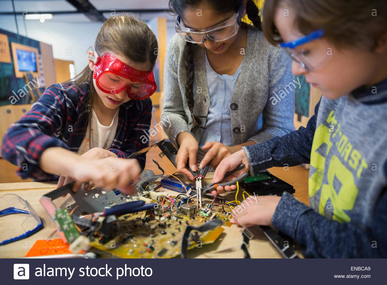 Students in goggles assembling electronic circuit science center Stock Photo