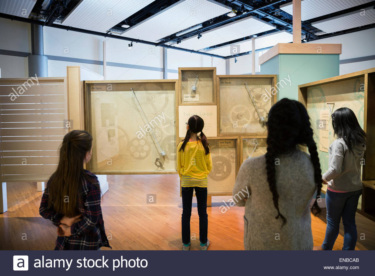 Students examining clock exhibit at science center - Stock Image