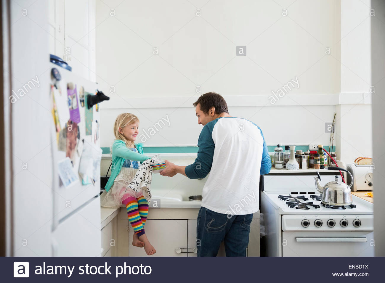 Father and daughter doing dishes in kitchen Stock Photo: 82000966 ...