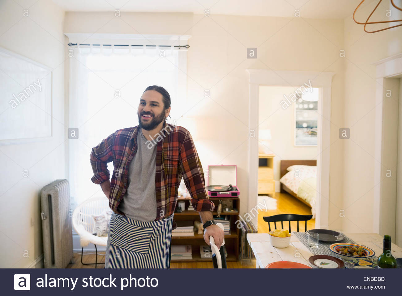 Portrait smiling man preparing for dinner party - Stock Image