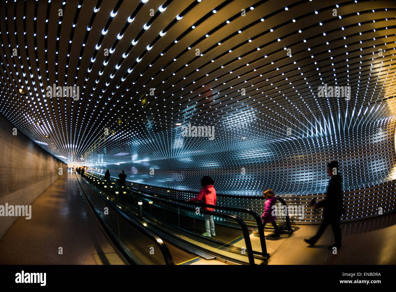 WASHINGTON DC, USA - Visitors move along a move walkway under an LED light installation by American artist Leo Villareal - Stock Image