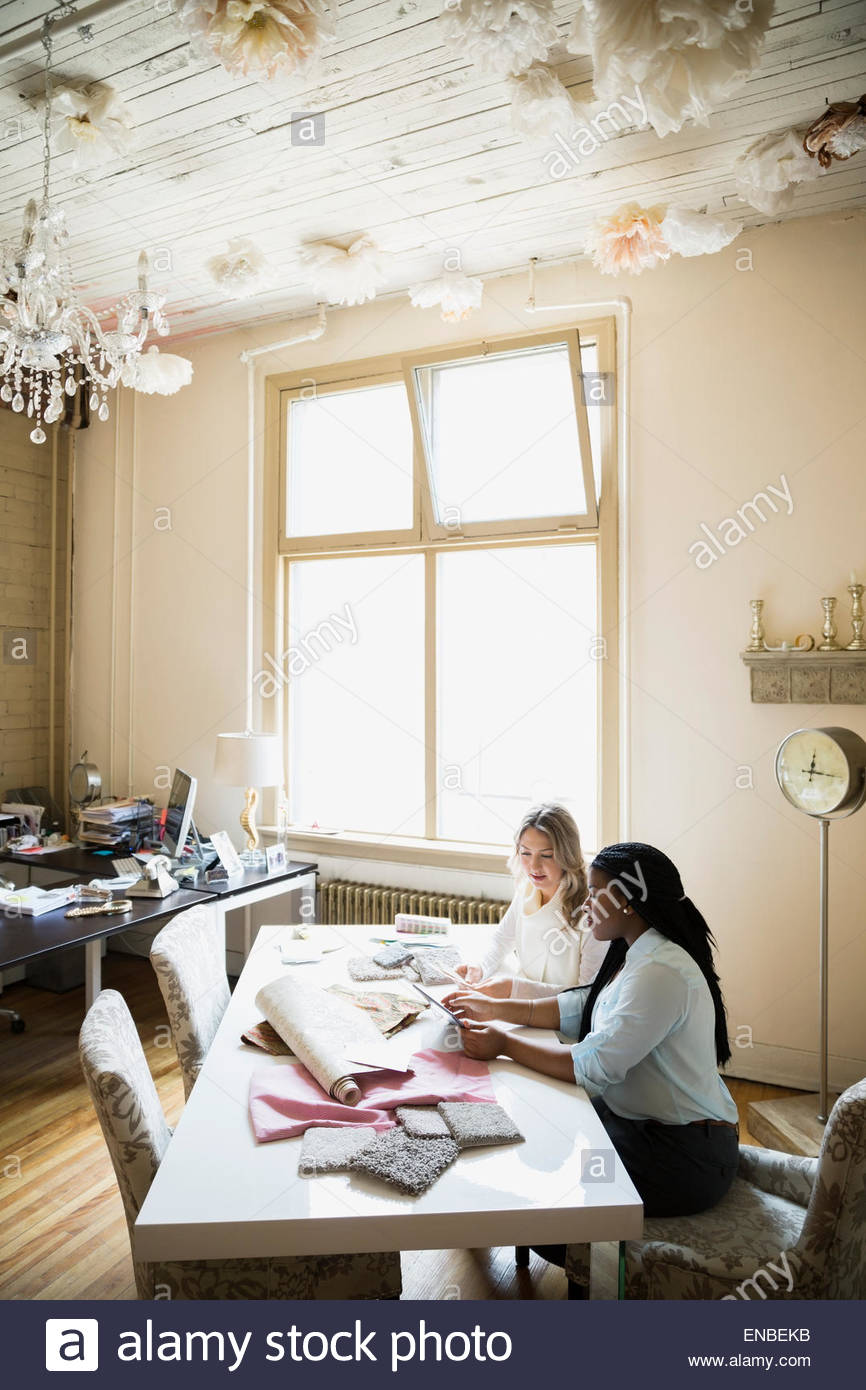 Interior designers looking at swatches in office Stock Photo