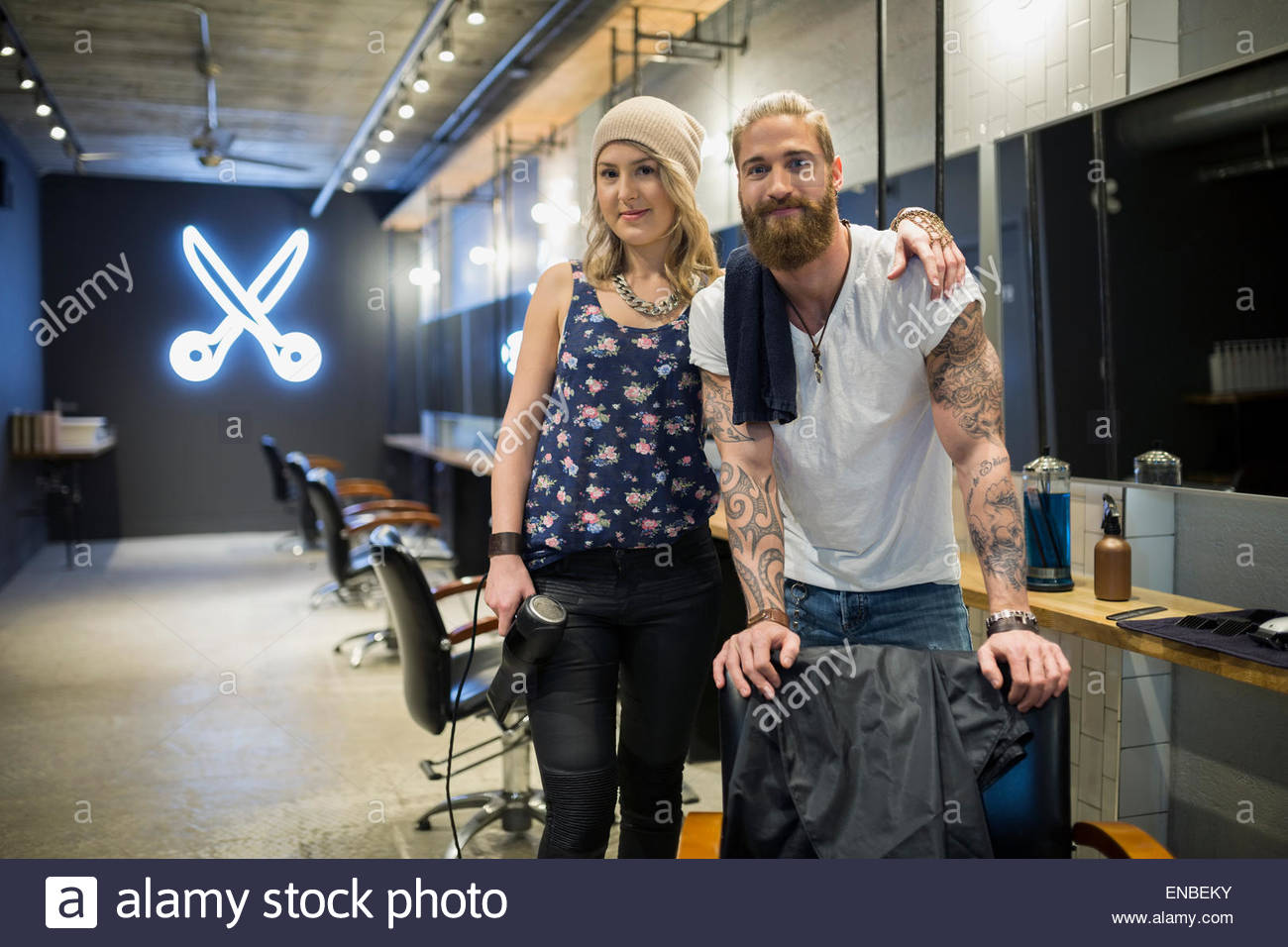 Portrait confident hipster hairstylist partners in hair salon - Stock Image