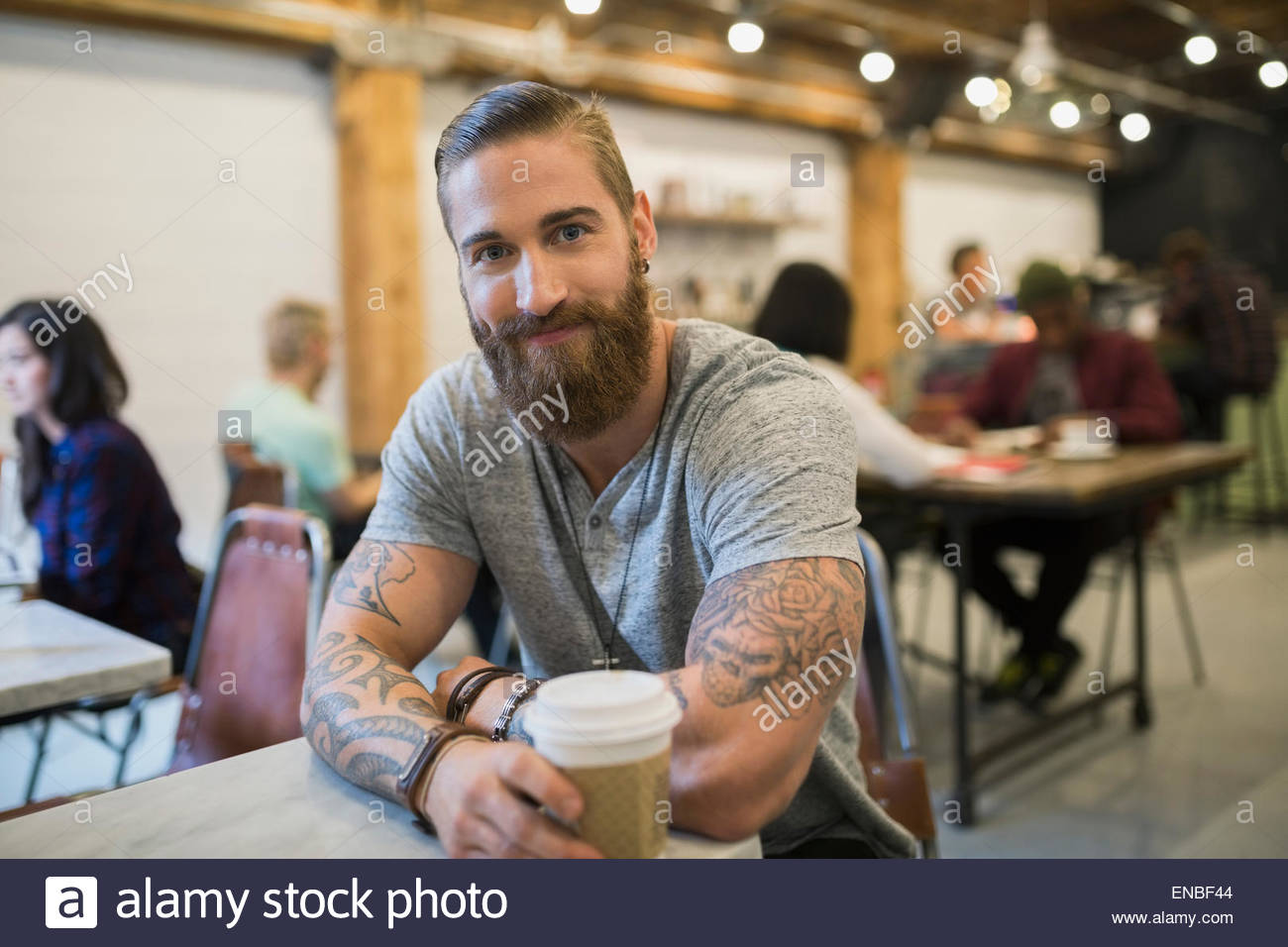 4991e67f5 Portrait confident bearded man with tattoos drinking coffee Stock ...