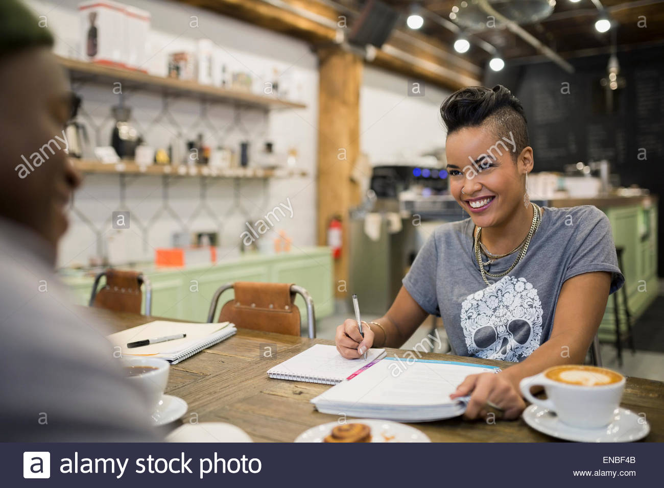 Smiling couple studying in cafe Stock Photo