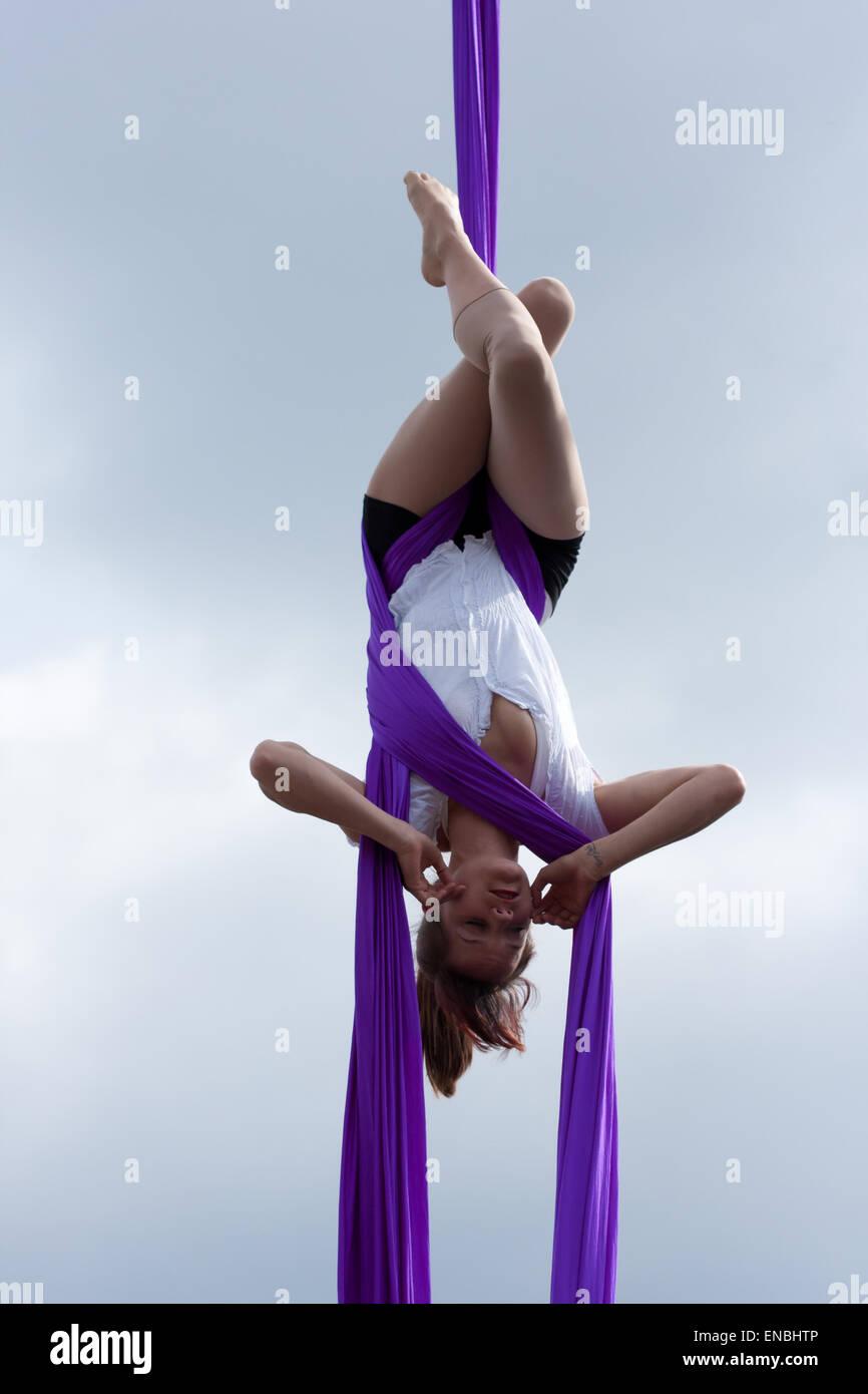 Circus artist Aislinn Mulligan performs an aerial silks act on the Cirque Bijou circus stage at Bristol's 2012 - Stock Image