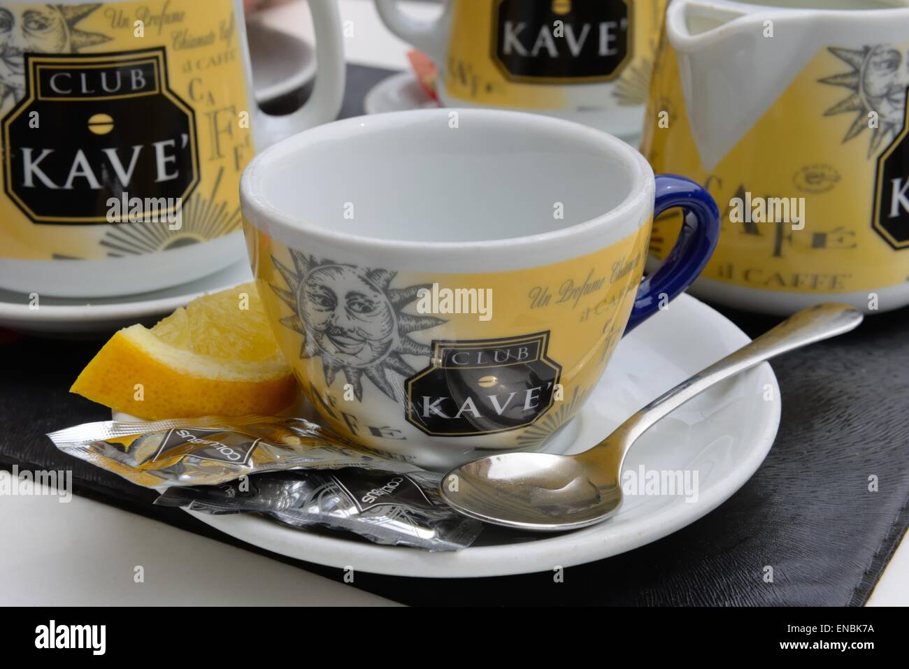 Close up of a Club Kave coffee / tea cup with slice of Lemon - Stock Image